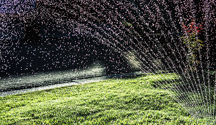 A Lawn Sprinkler System Beautifies The Yard Conserves