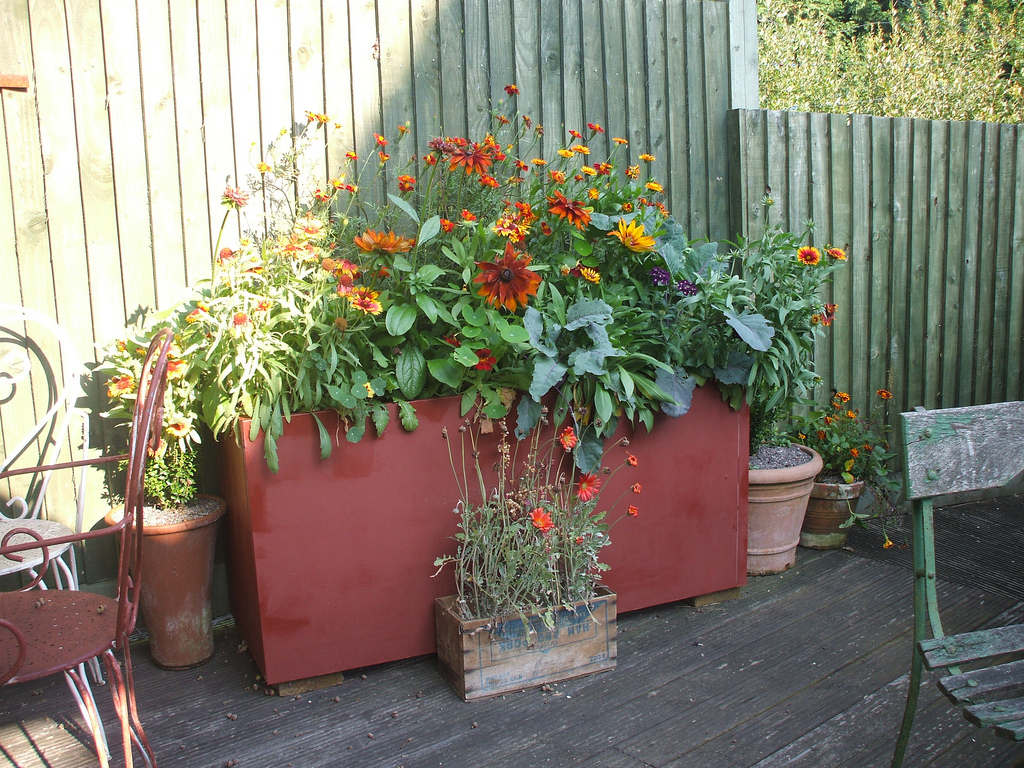 Six ideas for a recycled garden planter coldwell banker blue matter - Recycled containers for gardening ...