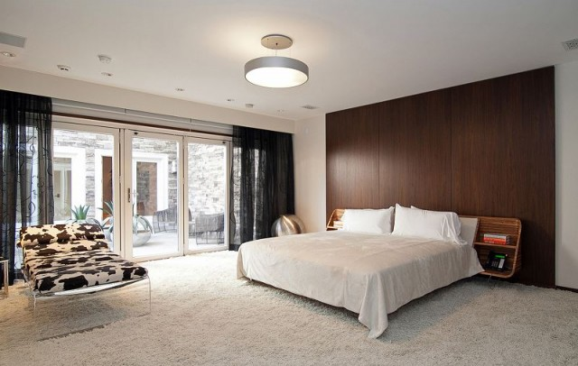 10 ways to incorporate wood and stone into modern design - Floor to ceiling headboard ...