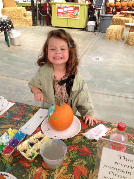 Painting a pumpkin for one of the many fall activities in the Grand Rapids area