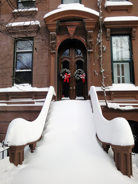 brownstone covered in snow in NYC
