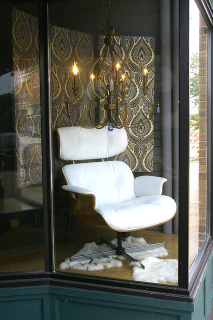 eames chair w/chandelier and sheepskin rug