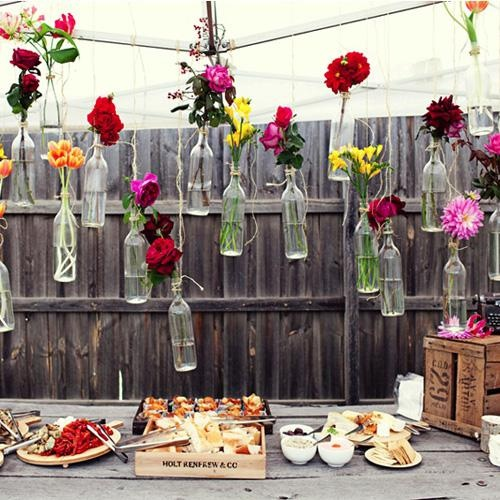 festive table linens big white umbrellas to shield guests from the sun are essentials for an outdoor tablescape photo via hostess with the mostess blog