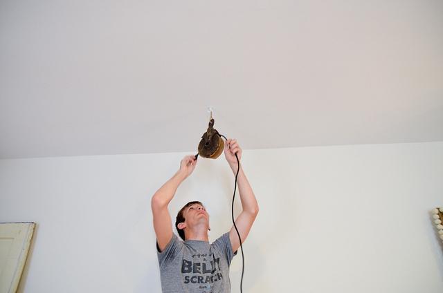 man changing lighting in apartment