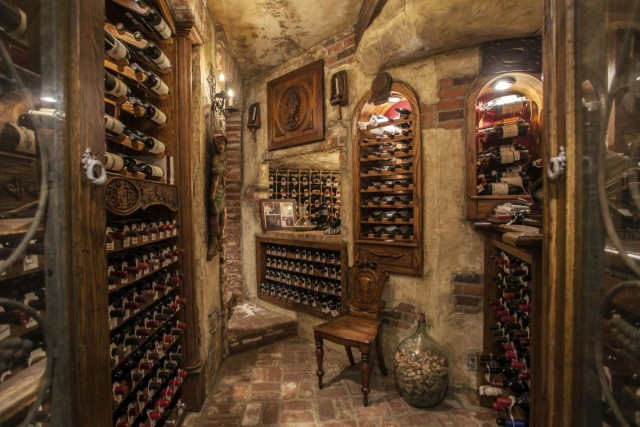 The temperature controlled 4,000 bottle wine room in this Corona Del Mar, CA property listed by Georgina Jacobson with Coldwell Banker Residential Brokerage brings new meaning to ambiance.
