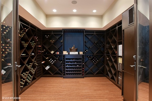 The modern wine room in this Chicago, IL home listed by Chezi Rafaeli dwarfs many walk-in-closets.