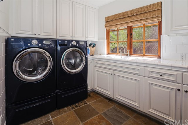 This Laguna Beach, CA home's laundry room shows that black is always in.