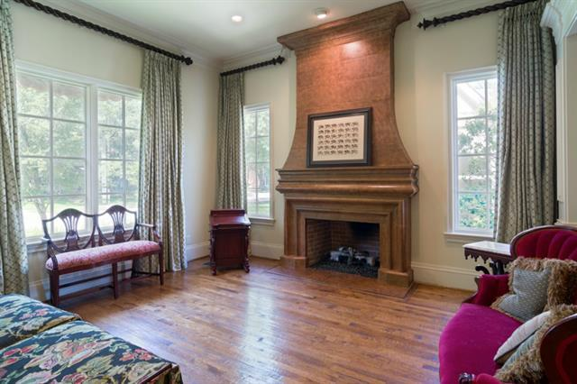 A classic oak-manteled fireplace gives this Highland Park home a classic look.