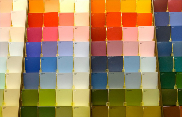 Image of a row of paint swatches in a store