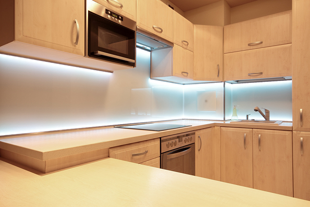 When installing under-cabinet lights, position them near the front of the  cabinet, not close to the wall, to fully