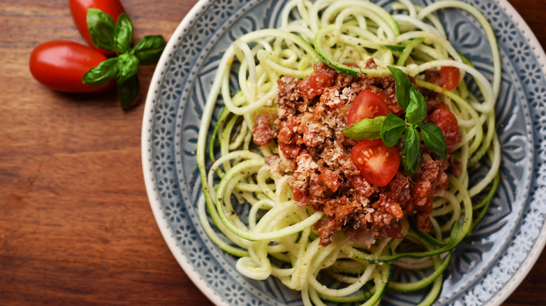 Zucchini noodles called zoodles with vegan bolognese and yeast flakes – vegan, healthy food!