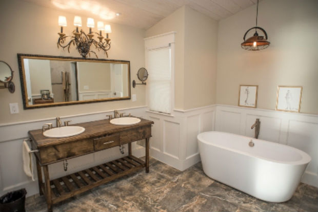 Located on the Intracoastal in St. Augustine, FL this home's master bath has a custom vanity with his and hers sinks, freestanding oval bathtub and a walk-in shower with dual shower heads. There's even an electric towel warmer just in case it gets too chilly in that Florida A/C. Ready to spend the afternoon in this soak tub? It's located at 2741 Harbor Court, Saint Augustine, FL and is listed for $1,399,000 by Jane Wolfe with Coldwell Banker Premier Properties.