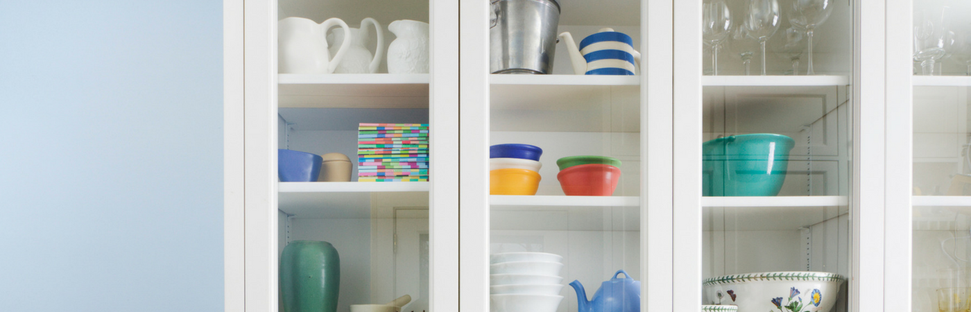 The Trick to Organizing a Kitchen with Glass Front Cabinets ...