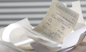 stack of the receipt on the table