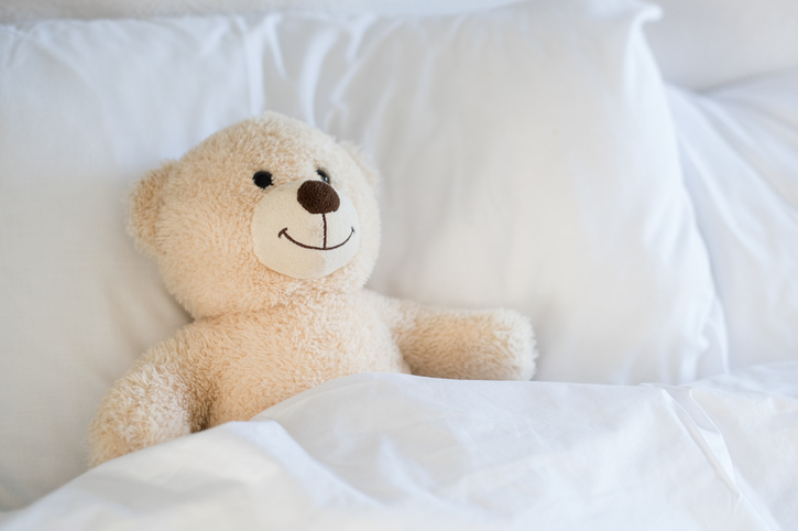 Teddy bear on bed