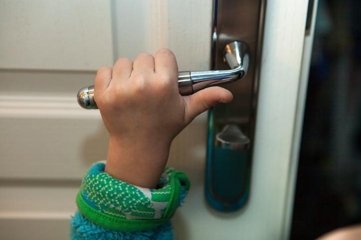 Children hand open door handle