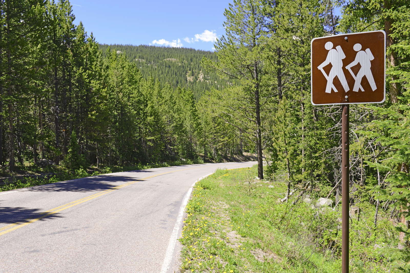 Hiker - backpacker Crossing sign in the outdoors